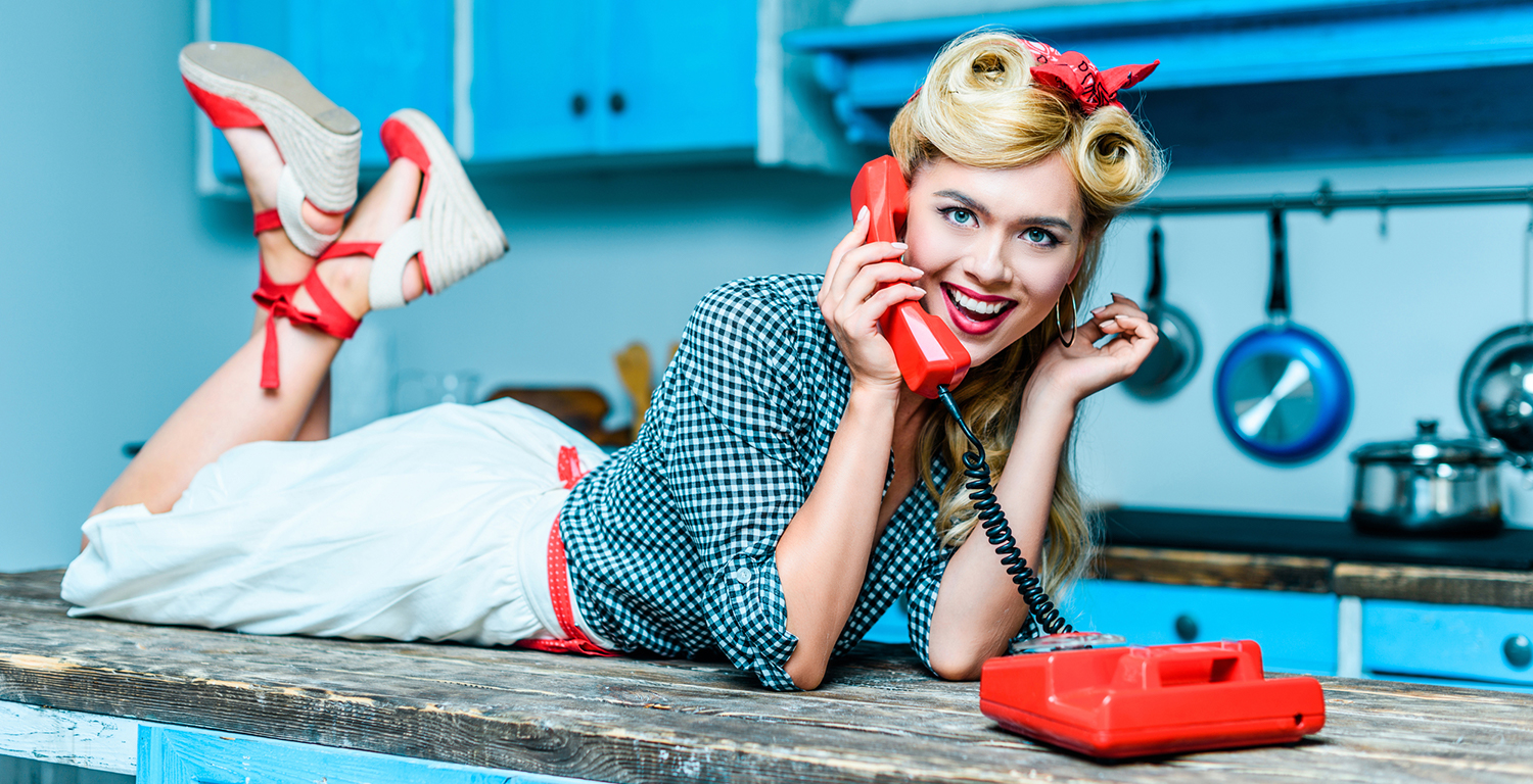young woman on retro phone